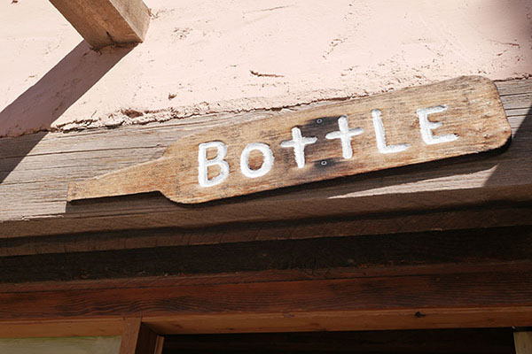 Hand carved sign for Bottle Room