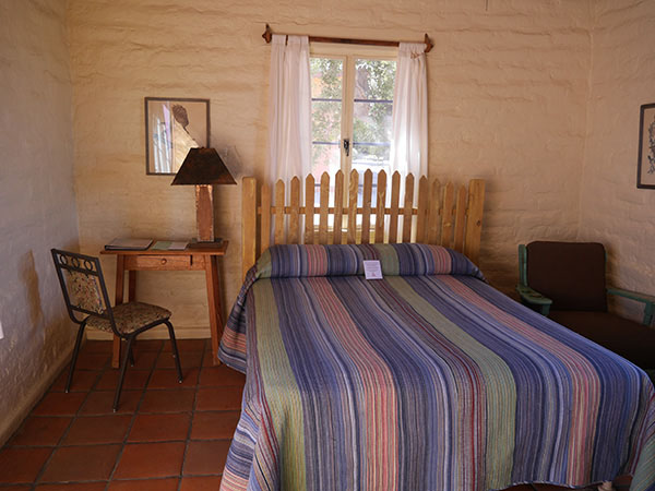 Queen bed inside Encelia Adobe Bungalow