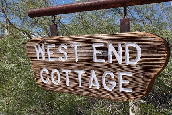 Hand carved West End Cottage sign